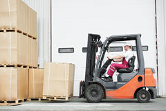 Worker driver at warehouse forklift loader works Royalty Free Stock Images