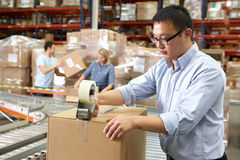 Workers In Distribution Warehouse Stock Photography