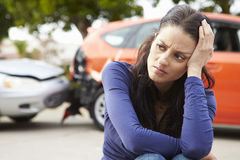 Worried Female Driver Sitting By Car After Traffic Accident Stock Images