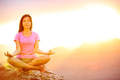Yoga woman meditating at sunset in Grand Canyon Royalty Free Stock Images