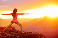 Yoga woman meditating at sunset in Grand Canyon Stock Image