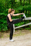 Young adult woman stretching Stock Photography