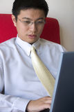 Young Asian Entrepreneur Working Royalty Free Stock Image