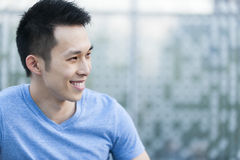 Young asian man smiling Stock Image
