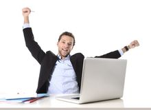 Young attractive businessman happy and hectic at office work sitting at computer desk satisfied celebrating Royalty Free Stock Images