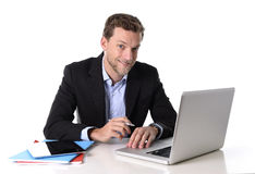 Young attractive businessman working happy at computer desk satisfied and smiling relaxed Royalty Free Stock Images