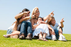 Young attractive family pointing Stock Images