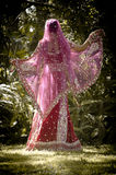 Young beautiful Indian Hindu bride dancing under tree Royalty Free Stock Photos