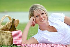 Young Blond Woman on Picnic with Wine Stock Images