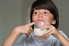 Young boy drinking milk Stock Photos