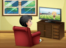 A young boy watching TV at the living room Stock Photos