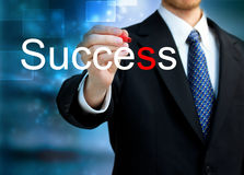 Young business man writing the word Success Royalty Free Stock Photos
