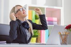 Young business woman enjoying success at work Stock Photos