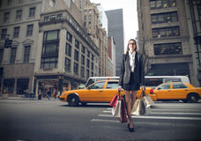 Young business woman with lots of shopping bags Stock Image