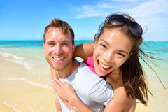 Young couple having fun laughing on beach holidays Stock Photo