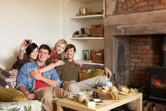 Young couples in cosy cottage Stock Images