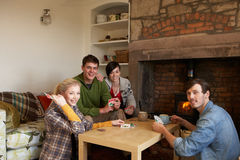 Young couples in cosy cottage Stock Image
