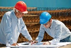 Young engineer and senior foreman Stock Photos