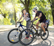 Young family on bicycles riding Royalty Free Stock Photography