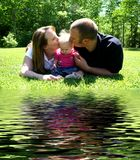Young Family kissing baby by W Royalty Free Stock Images