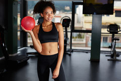 Young fit girl with toning ball at fitness club Stock Image