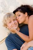Young girl kissing boys cheek Royalty Free Stock Photo