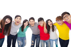 Young  group  with arms around each others shoulders Royalty Free Stock Image