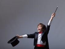 Young magician performing a trick Stock Photos