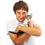 Young male holding a little kitten Stock Image