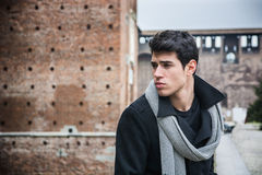 Young Man Outside the Building Looking Left Royalty Free Stock Photos