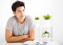 Young man reading  book  and thinking Royalty Free Stock Photo