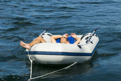 Young man relaxing in inflatable dinghy Stock Photo