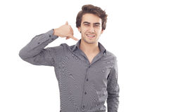 Young man showing a phone call gesture Stock Photography
