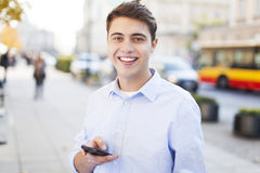 Young man texting Stock Photography