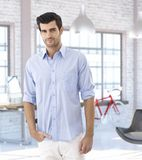 Young man at trendy modern home Stock Photo