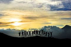 Young people jumping and having fun in the mountain Royalty Free Stock Photos