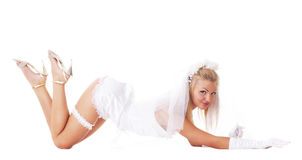 A young and sexy blond bride is lying on the floor Royalty Free Stock Photography
