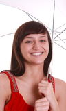 Young smiling girl holding umbrella. Stock Images