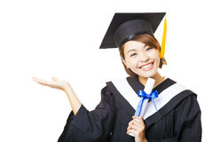 Young woman graduating holding diploma and showing gesture Stock Images