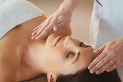 Young woman having a reiki treatment Royalty Free Stock Photo