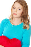 Young woman with heart shaped pillow Royalty Free Stock Photography