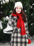Young woman with ice skate in winter outdoor Royalty Free Stock Photos