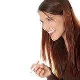 Young woman smoking electronic cigarette Stock Image