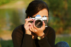 Young woman taking a picture Royalty Free Stock Photos