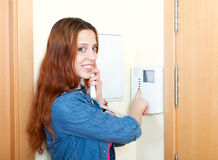 Young woman using house videophone indoor Stock Photo