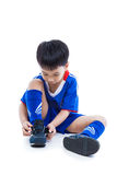 Youth soccer player tying shoe and prepare for competition. Spor Royalty Free Stock Photo