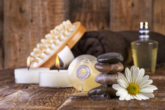 Zen basalt stones and spa oil with candles on the wood Royalty Free Stock Photography