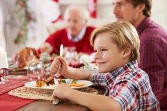 Zoon met Kerstmismaaltijd van Vaderand grandparents enjoying Royalty-vrije Stock Afbeelding